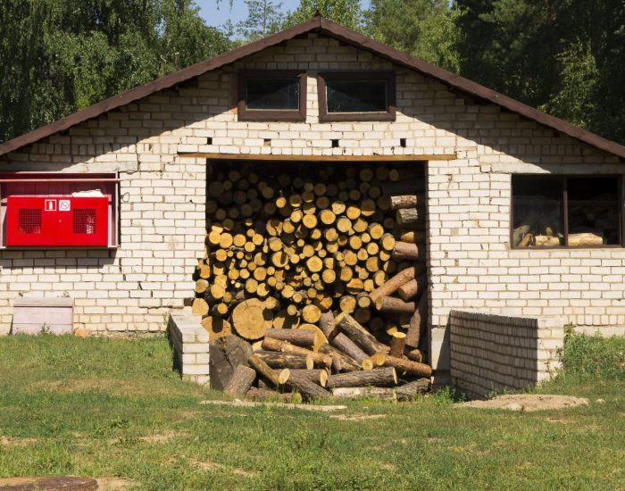 52999467 - crammed warehouse for wood firewood